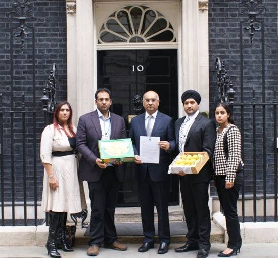 Delivering the last box of Indian mangoes to Mr David Cameron PM from Fruity Fresh before the EU ban on 1.5.2014